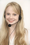 Blond mooi meisje op de Call centreachtergrond Stock Afbeelding