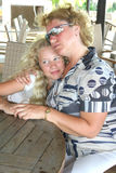 Blond mother and daughter stock images