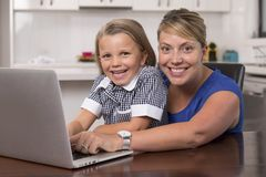 Free Blond Mother Woman Together With Her Young Beautiful And Sweet Little Girl 6 To 8 Years Old Sitting At Home Kitchen Enjoying With Royalty Free Stock Photography - 109119877
