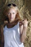 Blond near rock Royalty Free Stock Photography