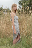 Blond near tall grass Royalty Free Stock Photos