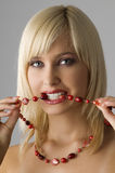 Blond with necklace Stock Images