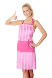 Blond nude woman in pink apron Stock Photo