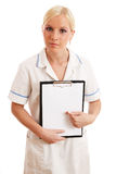 Blond nurse holding clipboard. Against white background royalty free stock images