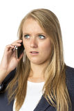 Blond phoning serious woman Stock Image