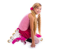 Blond pigtails roller skate girl on her knees happy Royalty Free Stock Photography