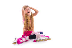Blond pigtails roller skate girl sitting happy Stock Photos