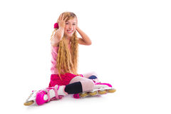 Blond pigtails roller skate girl sitting happy Stock Photography