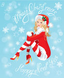 Blond Pin Up Christmas Girl wearing Santa Claus suit. And stockings on blue background with snowflakes. Handwritten text Merry Christmas and happy New Year Stock Images