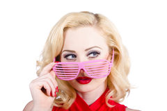 Blond pinup girl in stylish retro pink shades Stock Photography
