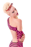 Blond pinup model looking over shoulder Stock Photography