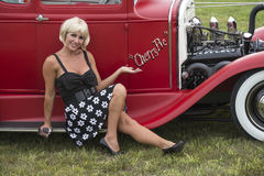 Blond pinup with vintage car Stock Images