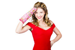 Blond pinup woman saluting in cooking glove Royalty Free Stock Image