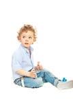 Blond pojke som bort ser Royaltyfria Bilder