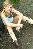 Blond portrait. Young blond teen in ponytails showing off her great legs Stock Images