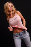 Blond Posing In Jeans And Pink Tank Top Royalty Free Stock Photography