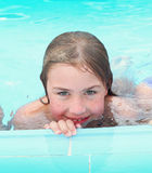 Blond preteen girl in swimming. Pool close up photo Stock Photography