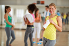 Blond pretty girl on break of training in fitness class Stock Photography