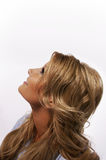 Blond pretty woman looking up Stock Image