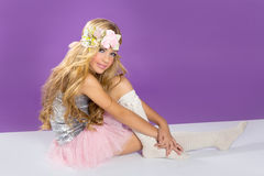 Blond princess fashion girl with spring flowers. Blond princess fashion girl fashiondoll with spring flowers on purple Stock Photography