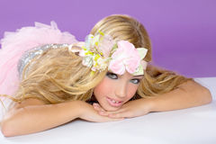 Blond princess fashion girl with spring flowers. Blond princess fashion girl fashiondoll with spring flowers on purple Royalty Free Stock Photography