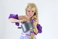 Blond princess with pan Stock Photos