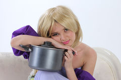 Blond princess with pan Royalty Free Stock Photo