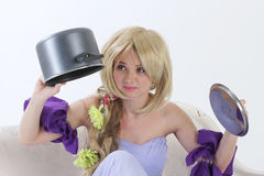 Blond princess with pan Royalty Free Stock Images
