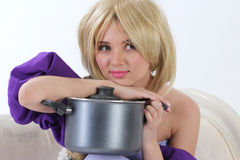 Blond princess with pan Stock Photo