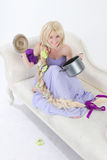Blond princess with pan Stock Images