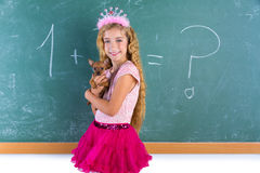 Blond princess schoolgirl pet chihuahua puppy Stock Photo
