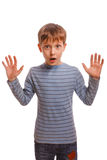 Blond raised his hands up child kid baby boy. Surprised surprise in striped sweater and jeans isolated royalty free stock photography