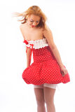 Blond in red dress Royalty Free Stock Photos