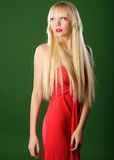 Blond in red dress Royalty Free Stock Image
