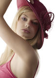 Blond with red fedora Stock Images