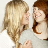 Blond and red haired girls are laughing Royalty Free Stock Photos