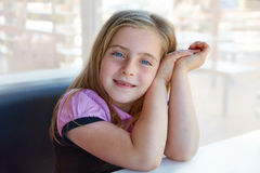 Blond relaxed happy kid girl expression blue eyes Royalty Free Stock Photos