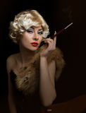 Blond retro-styled woman with cigarette Stock Photos