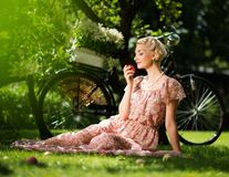 Blond retro woman on a meadow Stock Photos
