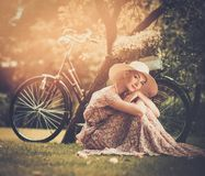 Blond retro woman on a meadow Stock Photography