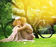 Blond retro woman on a meadow Royalty Free Stock Image