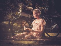 Blond retro woman on a meadow Royalty Free Stock Photography