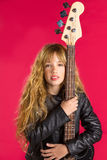 Blond Rock and roll girl with bass guitar on red Royalty Free Stock Image