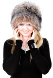 Blond Russian woman in fur hat Stock Image