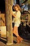 Blond on Rustic Column Royalty Free Stock Photos