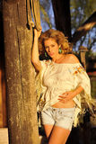 Blond on Rustic Column Royalty Free Stock Photo