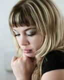 Blond sad girl. Blond girl thinking Royalty Free Stock Photography