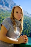 Blond sad woman feeling strong emotion in the mountain Stock Photography