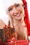 Blond Santa-girl with snow Stock Photo