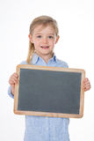 Blond schoolgirl on white background Royalty Free Stock Photography